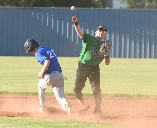 Lockeroom's Caleb Johnson attempts to turn a double play against Harrison on Monday.