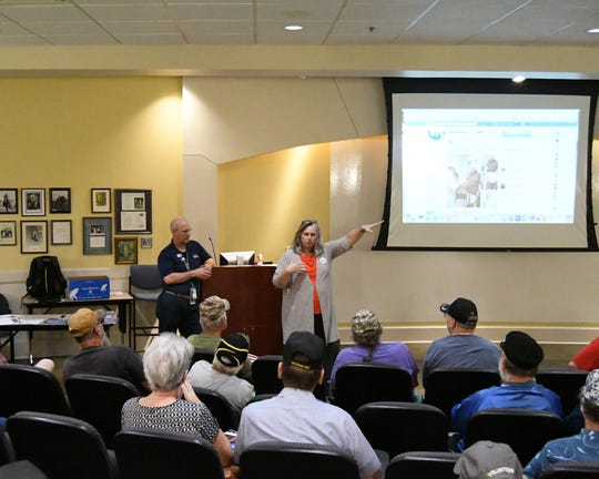 Central Arkansas Veterans Healthcare System officials (standing from left) Chris Durney and Dr. Tina McClain talk to area veterans Wednesday afternoon about the VA MISSION Act.