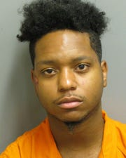 Jaquan Johnson was charged with second-degree assault, public intoxication and resisting arrest.