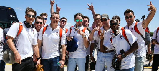 Members of the Auburn baseball team celebrate after landing in Omaha, Nebraska, where they will compete in the 2019 College World Series.