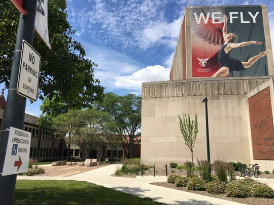 A sign on the Ball State campus on Wednesday directs families to parking for freshman orientation.