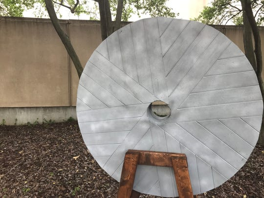 "Will Easter made a millstone prop out of structural foam board for the ""For Such a Time as This"" rally held Tuesday outside the Southern Baptist Convention's annual meeting."