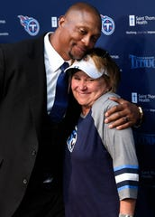 Former Titans running back Eddie George hugs Titans controlling owner Amy Adams Strunk as the team announces they will retire his and Steve McNair's jerseys during an a press conference at Saint Thomas Sports Park Wednesday, June 12, 2019, in Nashville, Tenn.