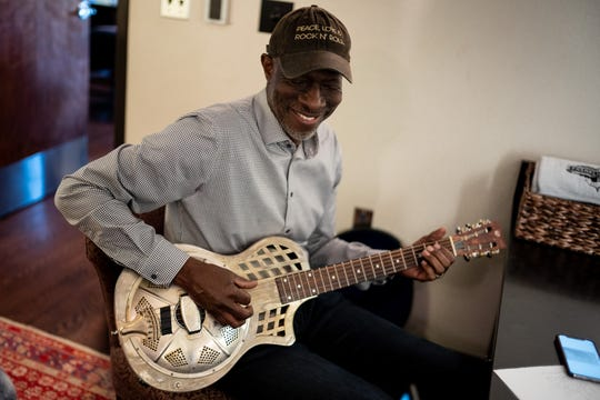Keb' Mo' warms up in his dressing room before a concert at the Franklin Theatre in Franklin, Tenn., Friday, June 7, 2019.