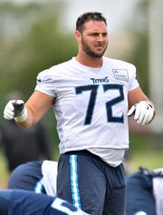 Titans offensive tackle David Quessenberry (72) stretches during practice at Saint Thomas Sports Park Wednesday, June 12, 2019, in Nashville, Tenn.
