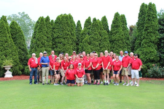 Team members volunteering at Tri Star Energy's annual golf tournament, benefiting Monroe Carell Jr. Children's Hospital at Vanderbilt.