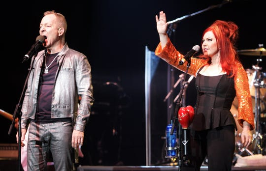 Fred Schneider, left, and Kate Pierson of the B-52s perform Wednesday, Oct. 31, 2007, in New York. The band's first new album in 16 years is due out in February. (AP Photo/Jeff Christensen)