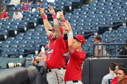 Fort Myers Miracle plays celebrating en route to their Florida State League first-half title.