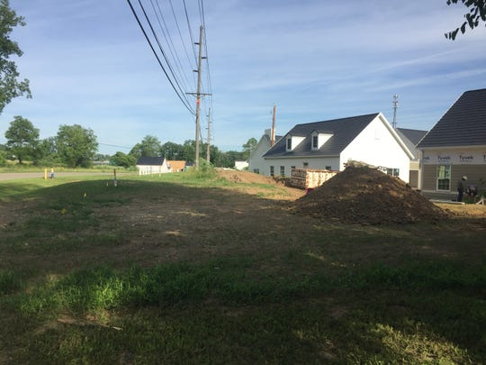 Seen from the parking lot at neighboring Snapshots, the pathway fronting Middleton will eventually extend in front of the lounge and beyond along Weaver Drive to connect to pathways on South Main Street.