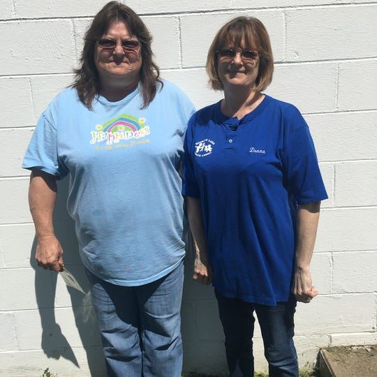 Jackie French (right), President of the Buckeye Lake Youth Association, and her sister, Donna Clary, member of the BLYA and responsible for building rentals and public relations, pose in front of the Youth Center in Buckeye Lake.