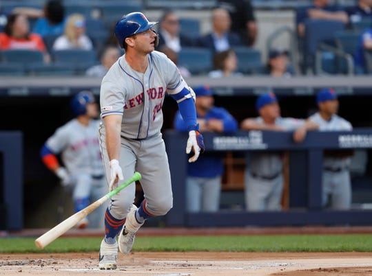 New York Mets' Pete Alonso watches his three-run home run during the first inning of the team's second game of a doubleheader against the New York Yankees, Tuesday, June 11, 2019, in New York.