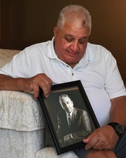 Jim DeSimone with a photo of his father Vincent J. DeSimone Jr. at his home in Wykcoff on Wednesday, June 12, 2019. Jim's father Vincent J. DeSimone Jr., as chief of detectives in Passaic County, played an instrumental role in the prosecution of Rubin (Hurricane) Carter and John Artis who were found guilty of a triple murder which took place in Paterson in 1966.