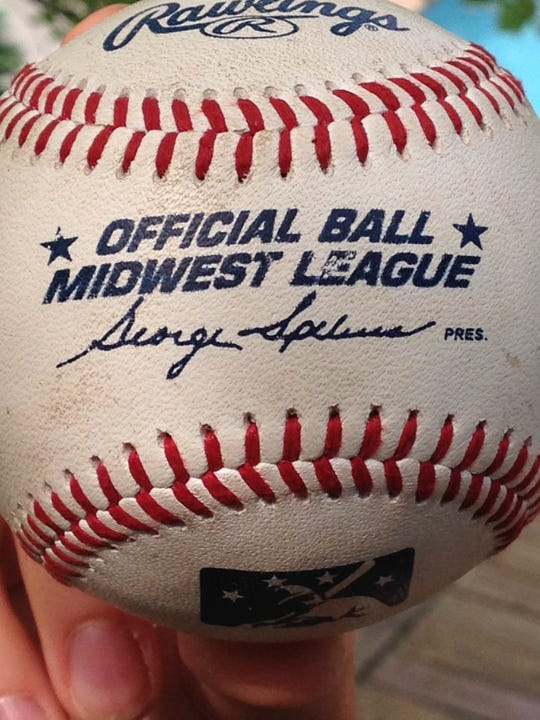 The home run ball that Conrad Gregor hit and his father, Marty, caught.