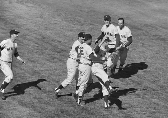 Yankees players celebrate at Candlestick Park, after beating the San Francisco Giants 1-0 in Game 7 of the World Series, Oct. 16, 1962. In group at center, first baseman Bill Skowron, left, and catcher Elston Howard (32) rush winning pitcher Ralph Terry. In background are shortstop Tony Kubek, left, and second baseman Bobby Richardson. Yankee teammate at extreme left unidentified. The Yankees had won nine of the last fourteen World Series. But it would be 15 years before the Yankees were world champions again.
