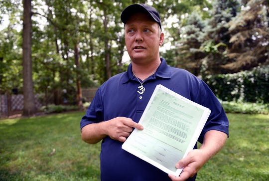 "Edward ""James"" Boyle of Williamstown points to his Bellwether Behavioral Health termination date. Boyle filed a whistleblower lawsuit against his former employer after he reported one of his clients had been sexually assaulted by another client in the group home he managed."