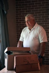 James De Simone with a folder holding pages of his father's memoir and a box of evidence from the Rubin (Hurricane) Carter and John Artis case at his home in Wykcoff on Wednesday, June 12, 2019. Jim's father Vincent J. DeSimone Jr., as chief of detectives in Passaic County, played an instrumental role in the prosecution of Rubin (Hurricane) Carter.