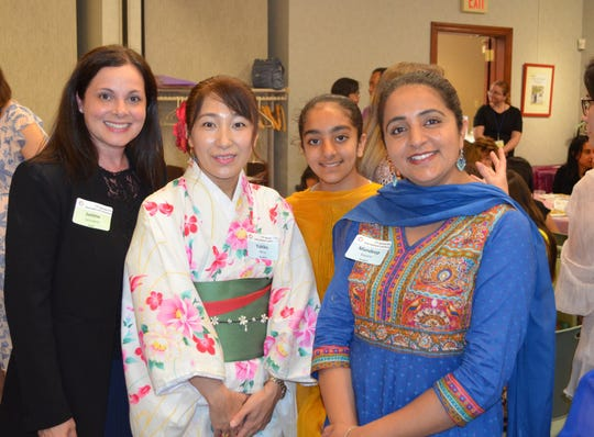Students and tutors attend the Ridgewood Library's ESL Luncheon on June 7.