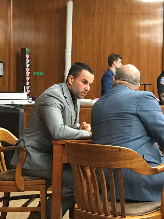 Marc Messing, left, speaks with his attorney during closing arguments on Wednesday.