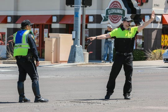 Officer John Guaderrama, a traffic investigator for the Las Cruces Police Department trains a new police service aide at the intersection of Walton Boulevard and Lohman Avenue in Las Cruces on Wednesday, June 12, 2019.