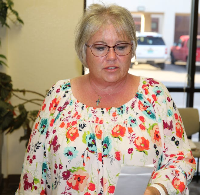 Paula Wallace, director of federal services and testing coordinator for the Loving Municipal Schools looks over unofficial numbers from a June 11 mill levy election.