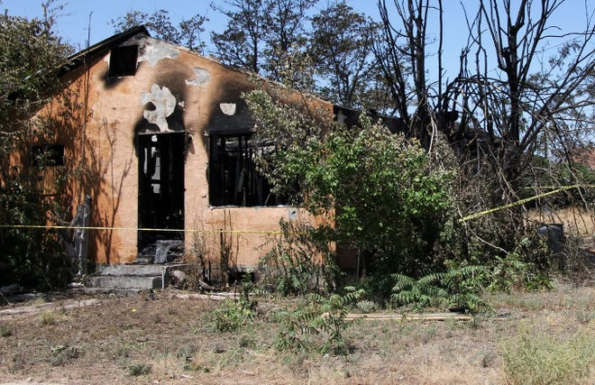 The remnants of a June 11 structure fire in Artesia. Anyone with information should call Eddy County CrimeStoppers.