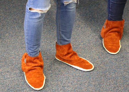 Students will keep the moccasins they made in class on June 12 at the Career and Technology Education Center in Farmington.