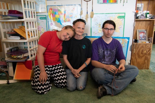 Sarah Burch, Christy Cartwright and Marcus Campbell at home in Carrizozo.