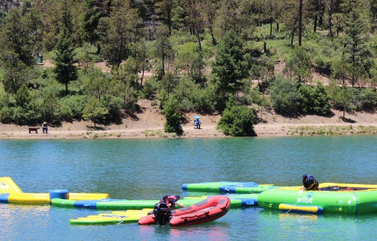 Piece by piece throughout the day, an inflatable water park called a Wibit began to take shape as a new attraction this year at Grindstone Lake in Ruidoso.