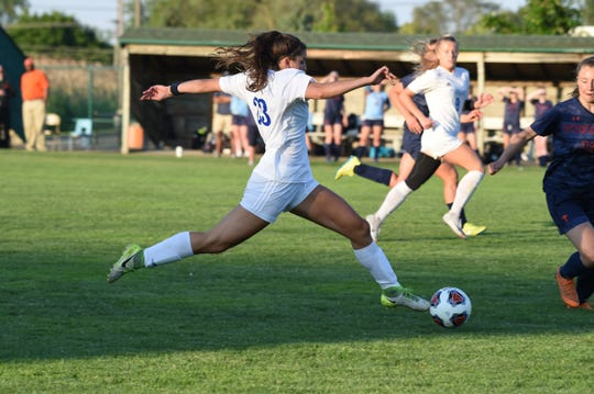 Marian's Morgan Cochran delivers a pass in the state semifinals against Flint Powers Catholic.