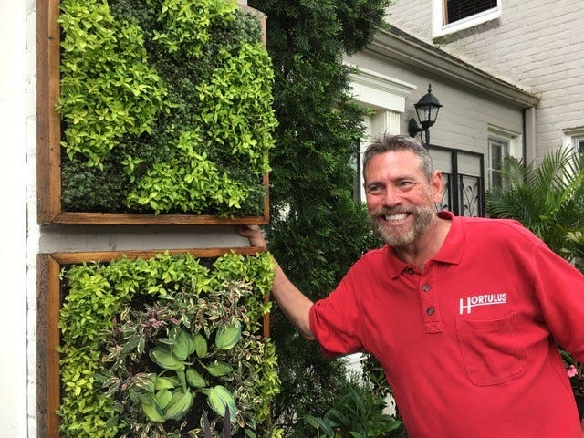On the Franklin Garden walk horticulturist Ed Blondin shows the X and O plantings which adorn the front of his home. The extensive gardens in his Lathrup Village yard area the site of weddings and social events.