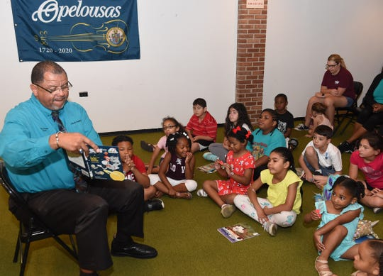 It's summertime and once again the Opelousas Public Lilbrary is holding their Summer Reading Program. Kicking off the event as a guest reader on Wednesday was Opelousas Mayor Julius Alsandor.