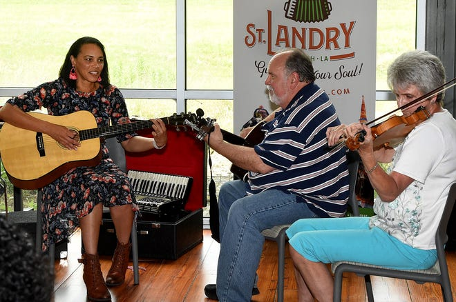 Tiffany Guillory Thomas, Don Fontenot and Bridget Murphy rocking out at the Zydeco Jam Saturday at the St. Landry Parish Tourist and Information Center.