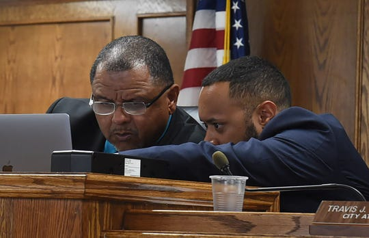 Opelousas Mayor Julius Alsandor, left, talks to city attorney Travis Broussard in a recent meeting of the Board of Aldermen. Broussard has said a proposed change to the city's liquor ordinance clarifies and simplifies the rules.