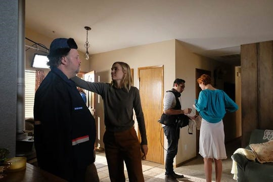 """Nora Kirkpatrick directing on set for """"Long Time Listener, First Time Caller""""."""