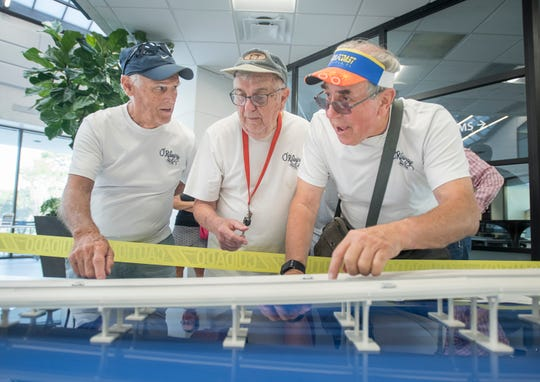 From left, Joe Bowman, Jim McAtee and Tom Riederer look over a model of the new Pensacola Bay Bridge during an FDOT public information open house at the Studer Community Institute building in downtown Pensacola on Tuesday.