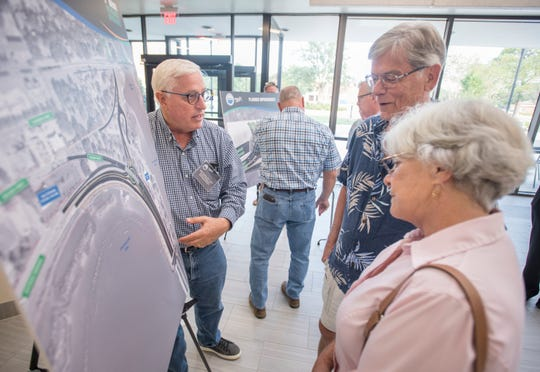From left, Brett Pielstick, Eisman & Russo CEI program director, Gene McCutchin and Becky Yonge discuss the Gregory Street and Bayfront Parkway at 17th Avenue interchange during an FDOT open house Tuesday at the Studer Community Institute.