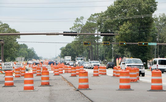 Traffic moves through construction along Nine Mile Road in Pensacola on June 12.