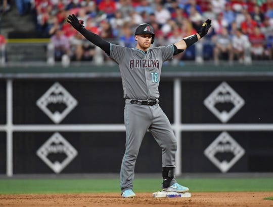 Jun 11, 2019; Philadelphia, PA, USA; Arizona Diamondbacks catcher Carson Kelly (18) reacts after hitting a two RBI double during the fourth inning against the Philadelphia Phillies at Citizens Bank Park. Mandatory Credit: Eric Hartline-USA TODAY Sports