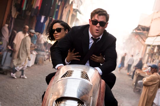 "Agent M (Tessa Thompson) and Agent H (Chris Hemsworth) are in pursuit in ""Men in Black: International."""