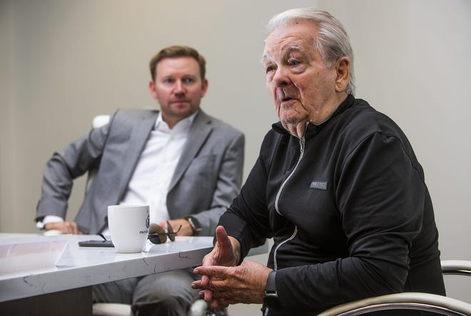 Attorney Christopher Charles (left) and his client, Fred Owens, talk about the reverse mortgage Owens got tangled up in.