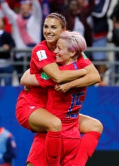 Jun 11, 2019; Reims, FRANCE; United States forward Alex Morgan (13) celebrates her fifth goal with forward Megan Rapinoe (15) against Thailand during the second half in group stage play during the FIFA Women's World Cup France 2019 at Stade Auguste-Delaune.