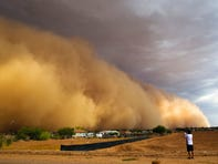 A dust storm engulfs a neighborhood on the Salt River Pima-Maricopa Reservation east of Phoenix, in April 2018.