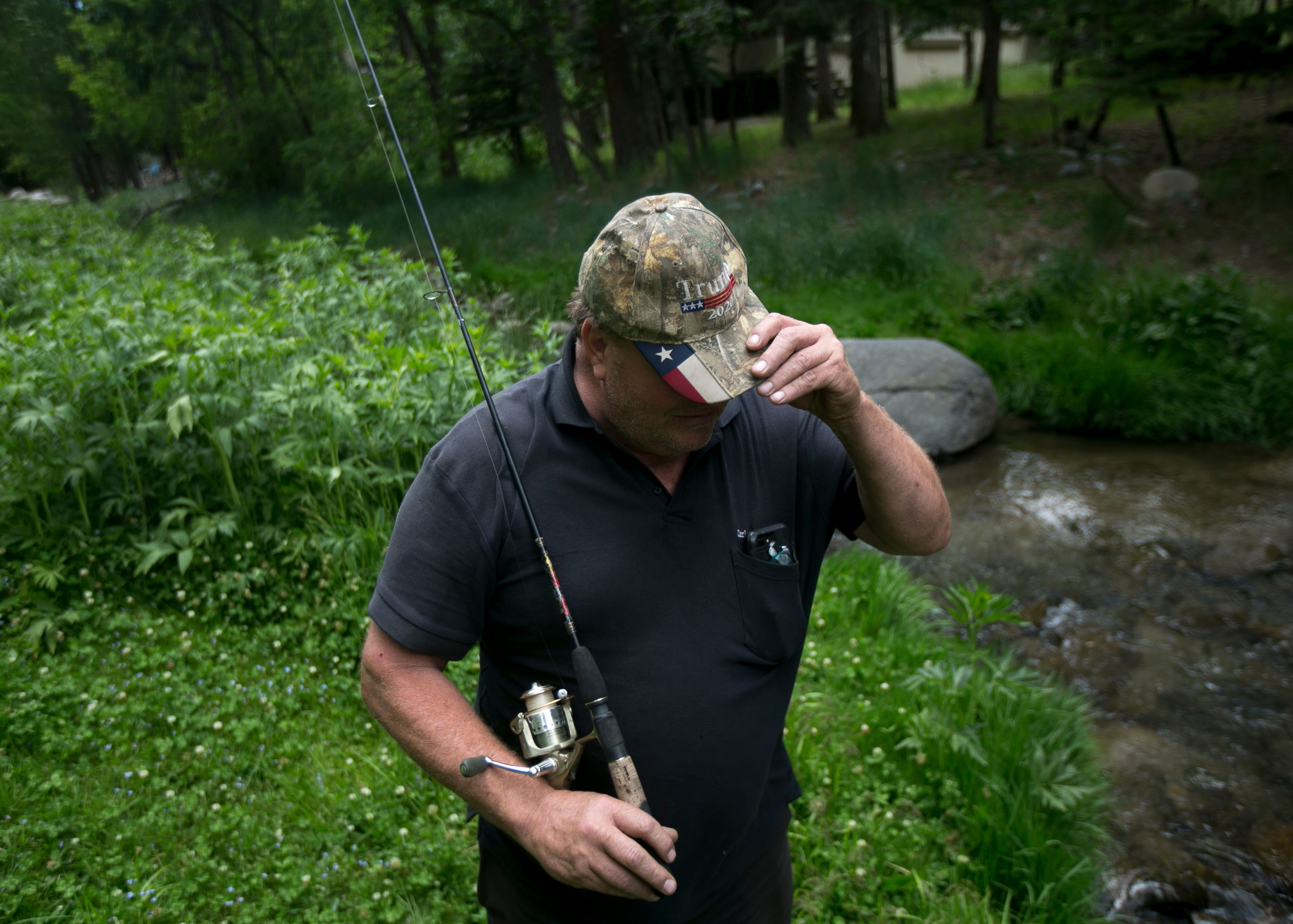 Jim Carlen, a tourist from Lubbock, Texas, fishes a creek in Ruidoso, New Mexico, on June 1, 2019. Carlen has been visiting for nearly 30 years.