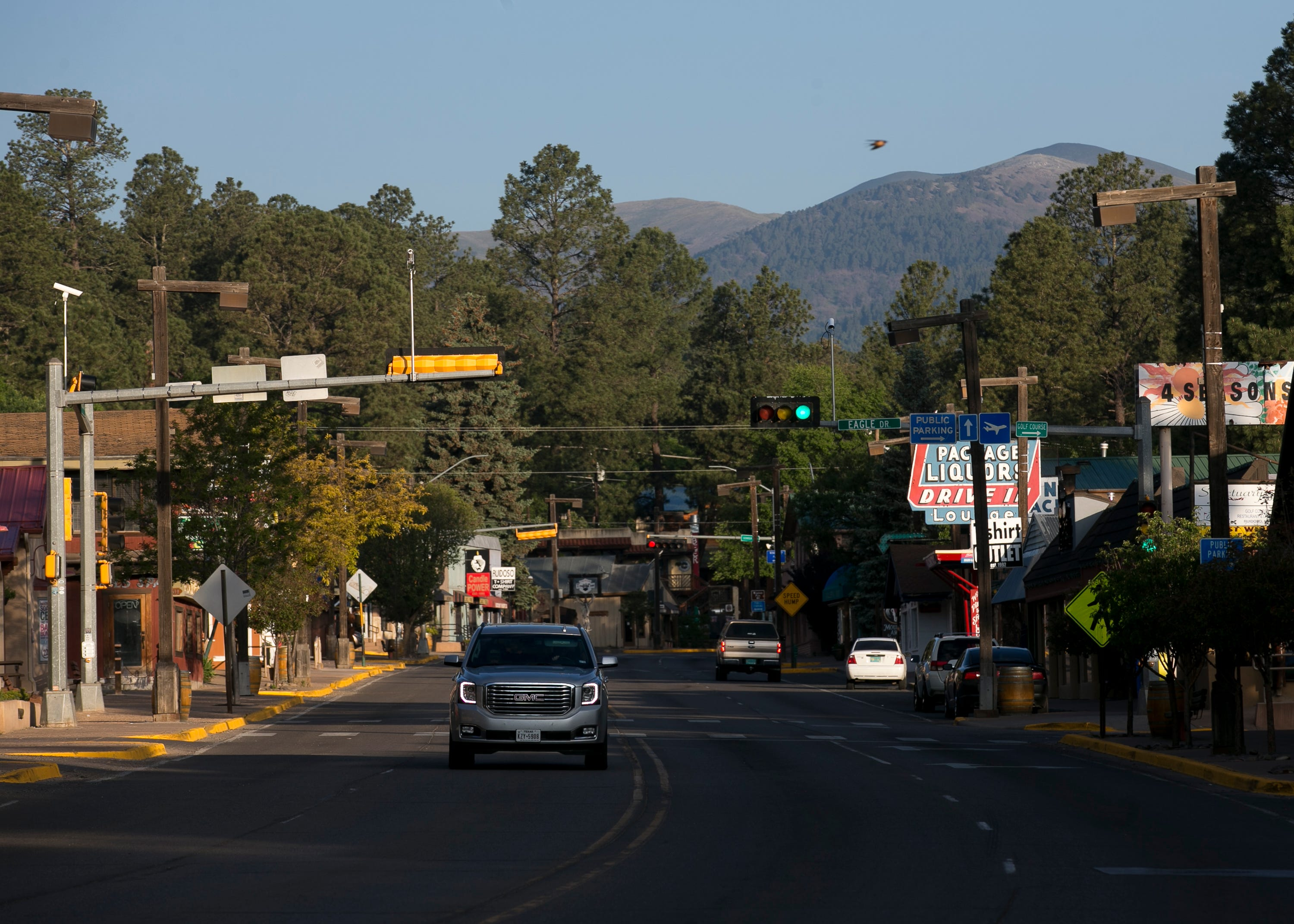 A vehicle drives through the main business strip in Ruidoso, New Mexico, on June 1, 2019.