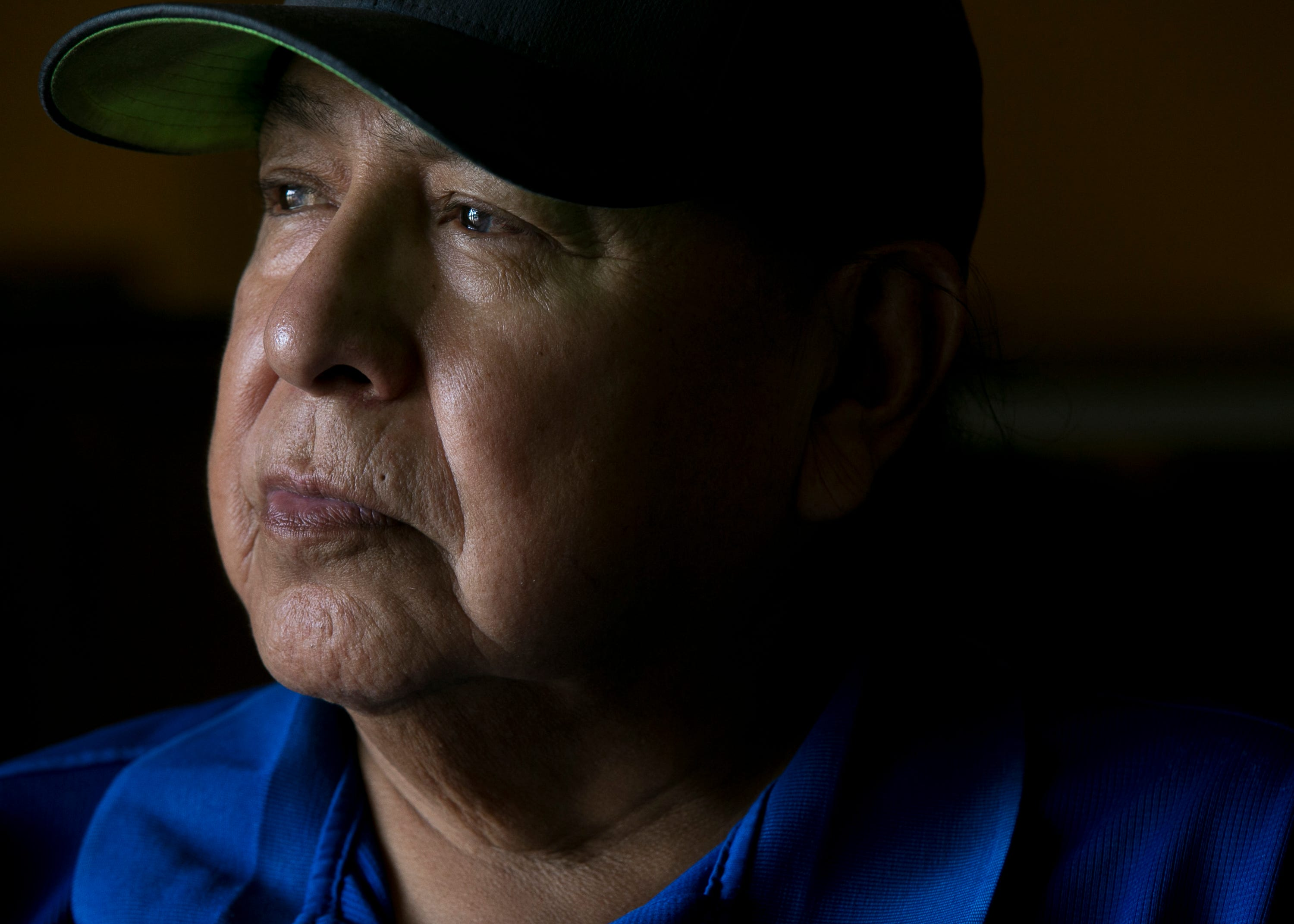 Freddie Kaydahzinne, a Mescalero Apache medicine man and director of the tribal museum, sits for a portrait in Mescalero, New Mexico, on May 30, 2019.