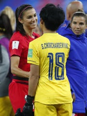 Jun 11, 2019; Reims, FRANCE; United States forward Alex Morgan (13)  greets Thailand goalkeeper Sukanya Chor Charoenying (18) after their match in group stage play during the FIFA Women's World Cup France 2019 at Stade Auguste-Delaune. Mandatory Credit: Michael Chow-USA TODAY Sports