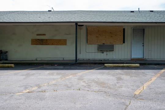 A room at the Days Inn in Port Huron is seen boarded up.