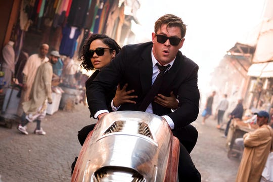 "Chris Hemsworth, foreground, and Tessa Thompson star in ""Men in Black: International."" The movie is playing at Regal West Manchester, Frank Theatres Queensgate Stadium 13 and R/C Hanover Movies."