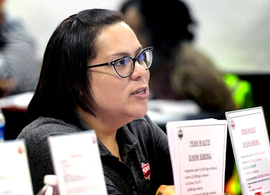 Penn Waste recorder Mariana Calderon speaks with a job seeker during a Second Chance job fair at the York County Administration Center Wednesday, June 12, 2019. The fair, sponsored by the York County Reentry Coalition, was for York County residents with a criminal background. Bill Kalina photo