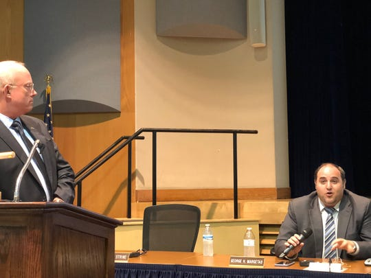 West York Area School Board member George Margetas debates with his fellow members about voting for the Lunch and Learn program. He argues in favor of giving it a try. Superintendent Todd Davies (left) looks on at a Tuesday meeting. (Photo: Lindsay C. VanAsdalan)